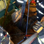 Norwalk firefighters rescue a man under the Stroffolino Bridge Saturday morning. (Courtesy Norwalk Fire Department)