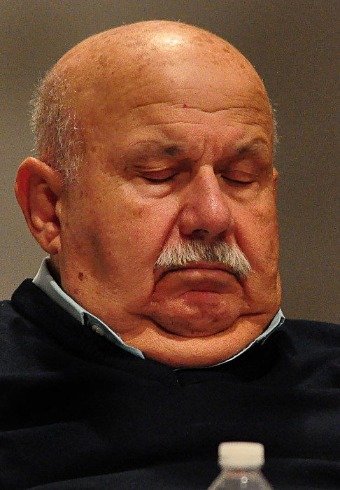 Common Council member Fred Bondi (R-At Large) takes a nap Tuesday evening as a member of the public talks about Washington Village at the council meeting.