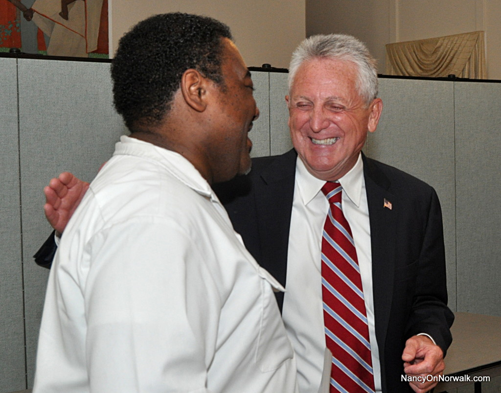 Norwalk Police Officer Carl Williams and former Norwalk Police Chief Harry Rilling chat Monday after Williams announced that the Norwalk Guardians Association is endorsing Rilling for mayor.