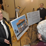 Frank Farricker, manager of the Wall Street Theater, explains the project to visitors in early March.