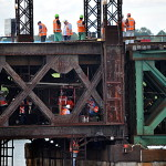 Metro-North workers attempt to close the Walk Bridge all the way Friday, June 6, in Norwalk.