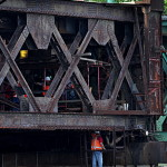 Metro-North workers try to close the Walk Bridge Friday in Norwalk.
