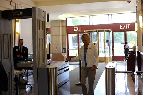 Rep. Pam Sawyer tries out the new turnstiles in the LOB (Christine Stuart photo)