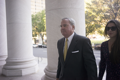 Former Gov. John G. Rowland walks into court last week with his daughter. (Douglas Healey file photo)