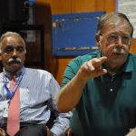 Department of Public Works Director Hal Alvord, right, talks at Monday's Mayor's Night Out about the difficulty in enforcing littering laws. You have to actually see the person littering to issue a ticket, he said.