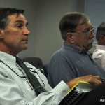 Planning and Zoning Director Mike Greene, left, waits along with Department of Public Works Director Hal Alvord and Redevelopment Agency Executive Director Tim Sheehan to speak to the Board of Estimate and Taxation recently.