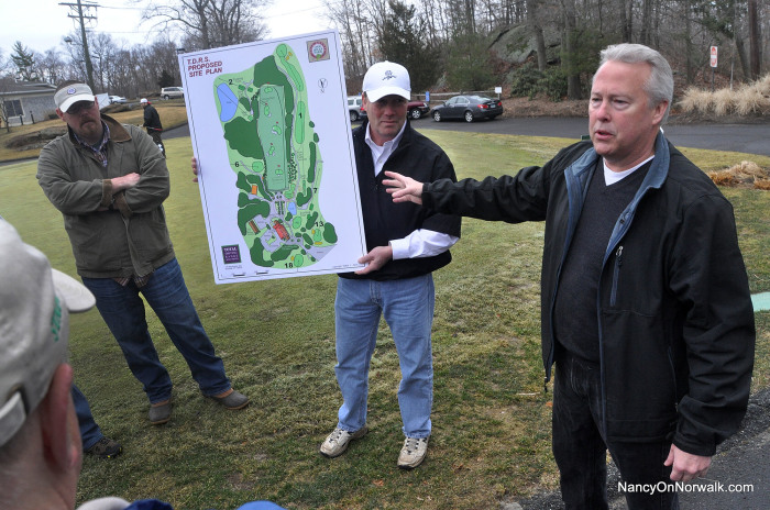 Jim Downing of Total Driving Range Solutions leads a tour of Oak Hills Park in March, showing off changes included in the OHPA master plan.