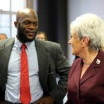 Onyeka Obiocha, chief financial officer of A Happy Life, talks to Lt. Gov. Nancy Wyman (Christine Stuart photo)