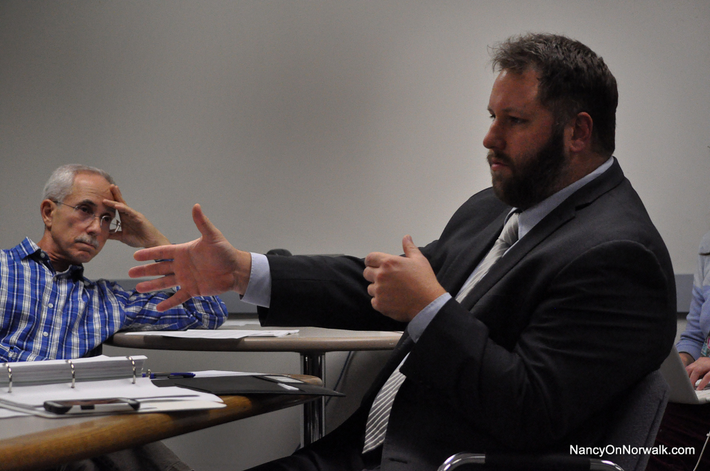 Assistant Corporation Counsel Brian McCann, right, talks about the ramifications of