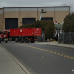 An AMEC Carting Co. truck leaves the company's Crescent Street transfer station Friday.