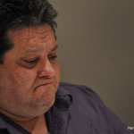 Norwalk Board of Education member Jack Chiaramonte pauses during his remarks at Tuesday's BoE meeting.