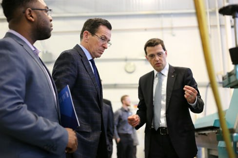 Gov. Dannel P. Malloy gets of tour of Leipold from its general manager Michael Kraemer. (Christine Stuart photo)