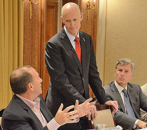 Florida Gov. Rick Scott meets with business owners Friday at the Norwalk Inn.    (Harold Cobin photo)