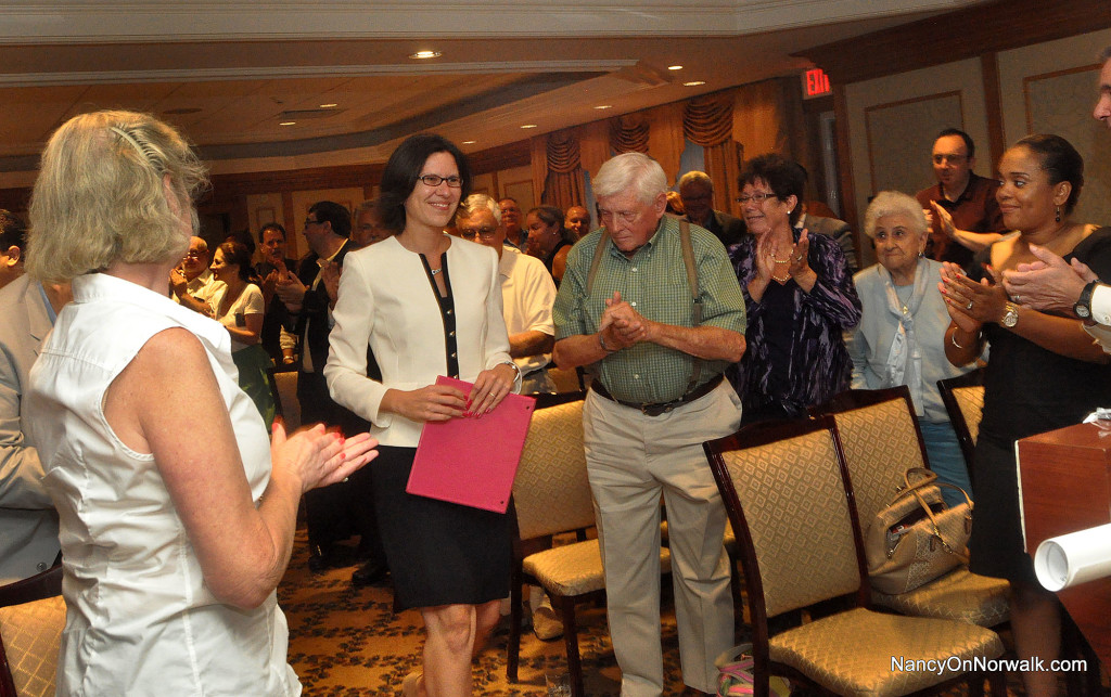 Norwalk Republican mayoral candidate Kelly Straniti heads to the lectern Monday to accept the nomination at the Republican Town Committee meeting in the Norwalk Inn.