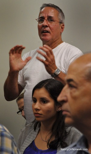 John Metsopoulos speaks at a Democratic Town Committee meeting.