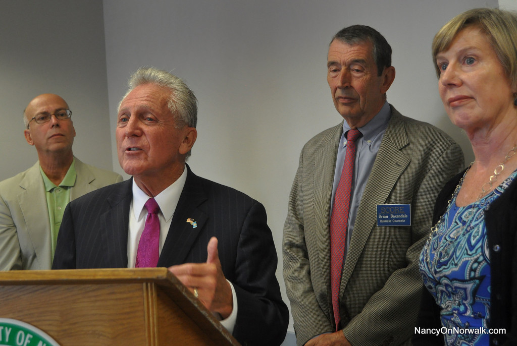 From left, Business Advisory Council Chairman Harry Carey, Norwalk Mayor Harry Rilling, Brian Baxendale of SCORE and Economic Development Director Elizabeth Stocker introduce the new Economic Development Action Plan on Wednesday in City Hall.