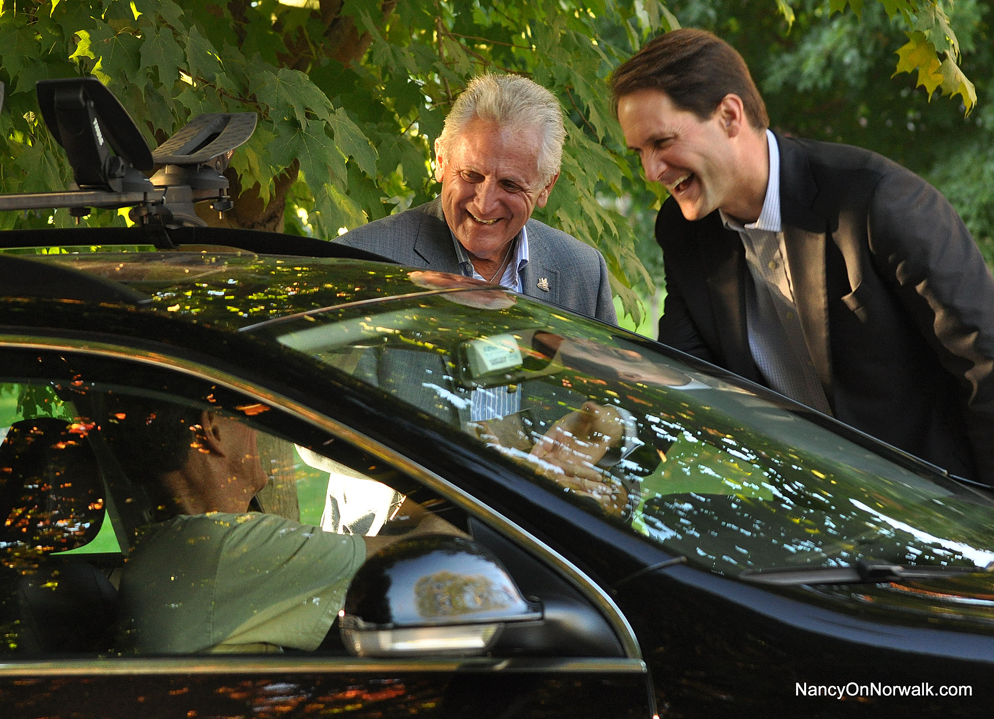 Norwalk Mayor Harry Rilling and U.S. Rep. Jim Himes (D-Greenwich) catch an East Norwalk resident on his way out his driveway Monday on Pine Hill Avenue.