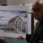 Attorney William Hennessey, at a recent Norwalk Zoning Commission meeting, shows an artists rendering of Bruce Beinfield's proposed home for 2 Nearwater Road.