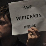 A New York City theater student holds up a sign last year