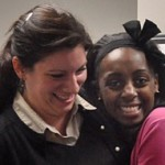 Tanasia Ticking, right, gets a hug from Theresa Argondezzi of the Norwalk Health Department after the presentation to the council committee. (Nancy Chapman file photo)
