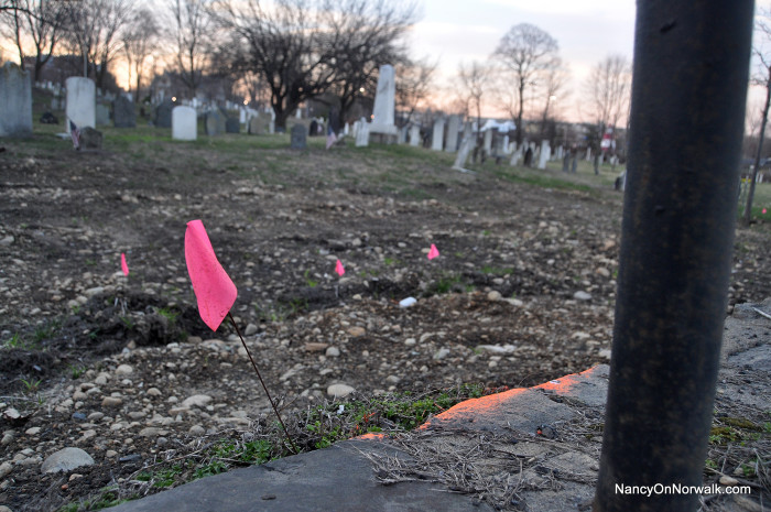 Flags dot the edge of the Pine Island Cemetery, where Crescent Street would be widened in a plan under consideration by the Norwalk Historical Commission. (March photo)
