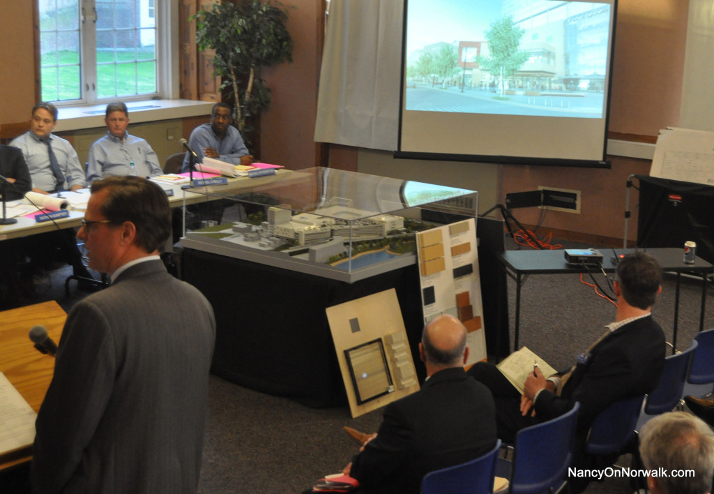General Growth Properties (GGP) Senior Developer Doug Adams, left, narrates as a video shows simulated 3-D views of The SoNo Collection from North Water Street and West Avenue to the Norwalk Zoning Commission.