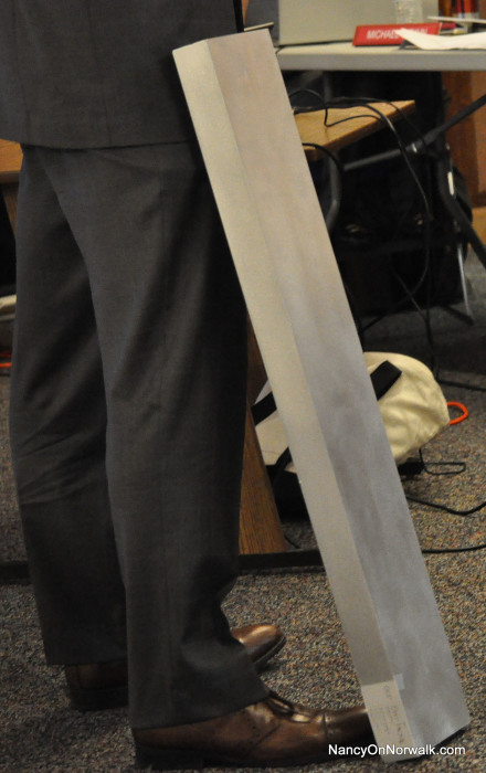 """A """"tube,"""" the type planned to be used on The SoNo Collection, rests against architect Robert Berry's leg as he talks to the  Norwalk Zoning Commission on Wednesday."""