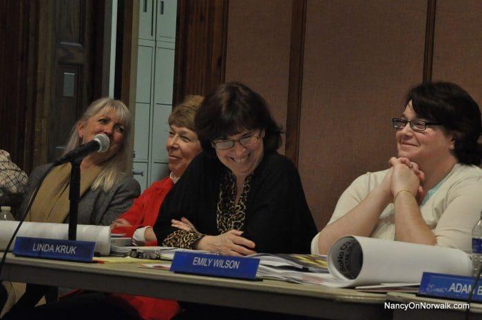 "From left, Norwalk Senior Planner Dori Wilson and Zoning Commissioners Jill Jacobson, Linda Kruk and Emily Wilson react to Mellodye Ragin's ""poker face"" line, Wednesday in City Hall."