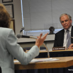 Norwalk Superintendent of Schools Steven Adamowski listens to Norwalk Federation of Teachers President Mary Yordon at the start of Tuesday's Board of Education meeting.