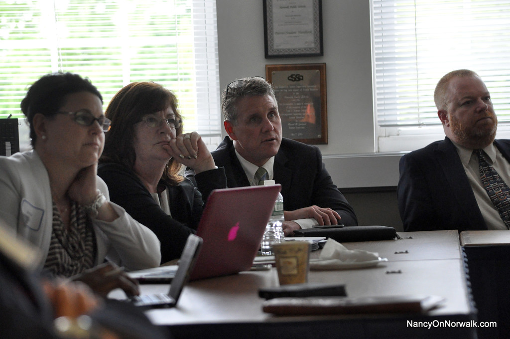 Norwalk Public Schools administrators listen to a presentation at a recent middle school redesign committee meeting in City Hall.