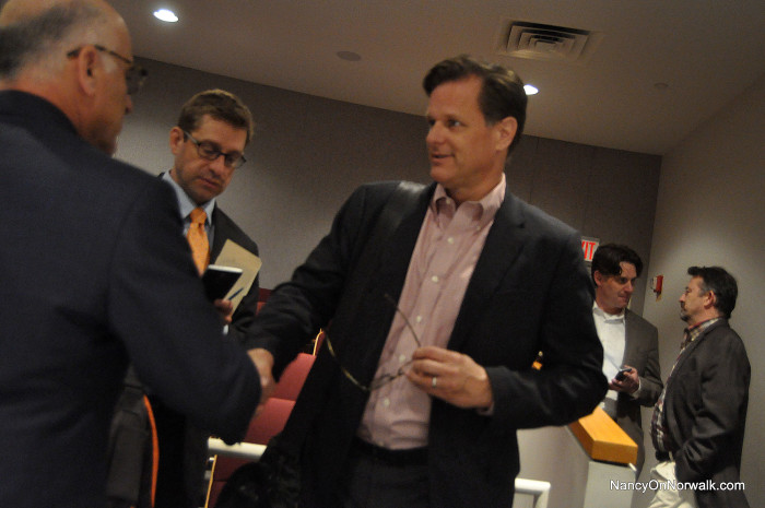 General Growth Properties (GGP) Senior Developer Doug Adams, center, shakes hands with Attorney William Hennessey on Wednesday after the Norwalk Zoning Commission approved GGP's plan for The SoNo Collection.