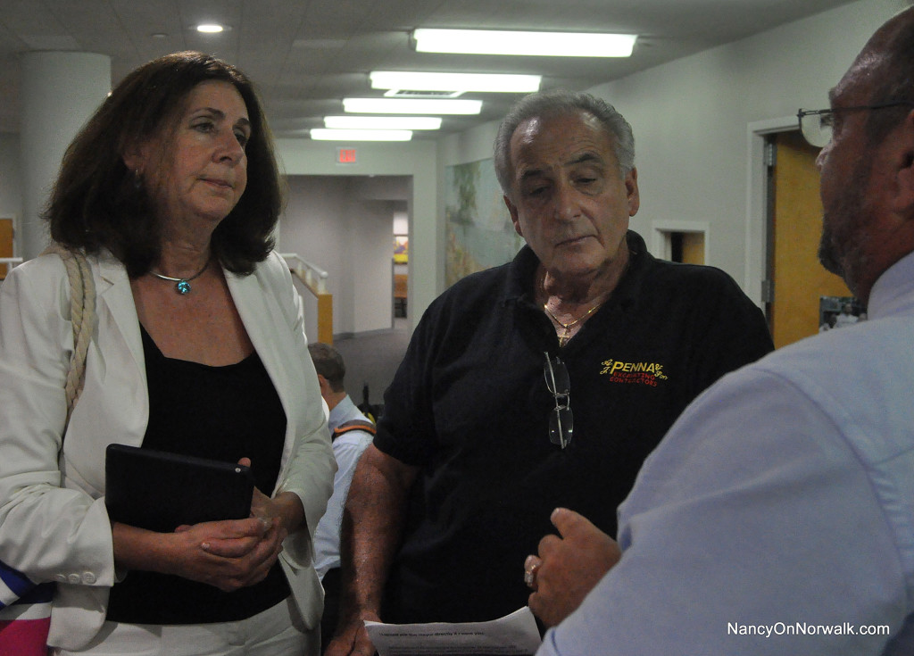 Robin Penna, left, and Vincent Penna, center, speak with