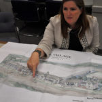 Norwalk Association of Silvermine Homeowners (NASH) President Heather Dunn shows off architect Bruce Beinfield's  concept drawing at last week's Coalition of Norwalk Neighborhood Association (CNNA) meeting.