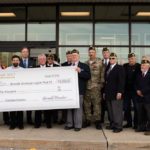 Members of the American Legion are presented with a ceremonial $10,000 check Thursday at LQR MKT.