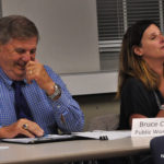 Norwalk Department of Public Works Director Bruce Chimento, left, and DPW Operations Manager Lisa Burns make light of their problems at Tuesday's Common Council Public Works Committee meeting in City Hall.
