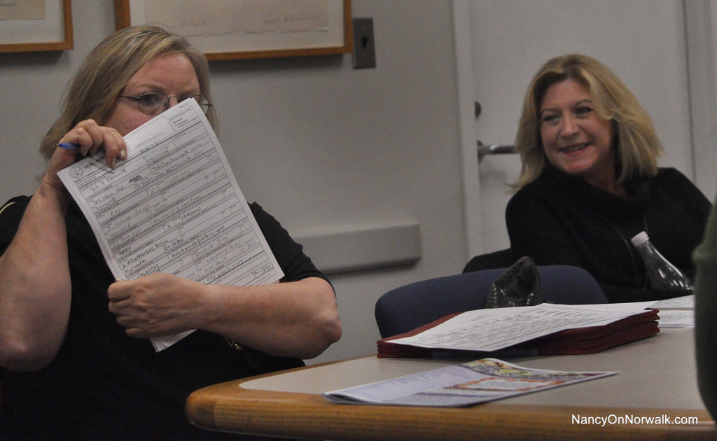 Diane Cece, left, at the Oct. 24 meeting of the Coalition of Norwalk Neighborhood Associations (CNNA) meeting in City Hall, holds up the papers filed by Yes4Norwalk with the town clerk's office.