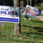 Campaign signs in East Norwalk, on Oct. 5.