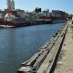 The northern end of the Norwalk River in April, with a barge moored at Devine Brothers. Imagine the number of trucks it would take to deliver the amount of aggregate on a barge, Harbor Management Commissioners said Wednesday.