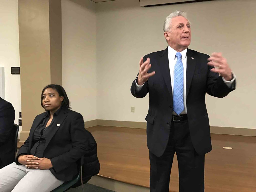 Mayor Harry Rilling, right, leads Monday's Mayor's Night Out, where he answered questions about the hiring of Norwalk firefighters. At left is