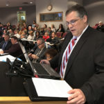SpEd Partners Co-Chairman Eric Neiderer speaks Tuesday at the Board of Education meeting.