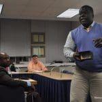 Columbus Magnet Schoool Principal Thomas Medard, right, shows off a camera used to teach Columbu
