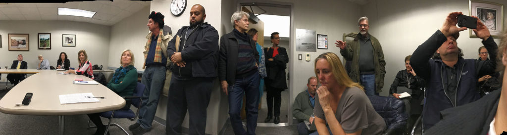 A panoramic photo shows the standing room only nature of Wednesday's Norwalk Parking Authority meeting in City Hall. Speaking to developers, at right, is Tod Bryant.