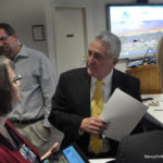 Mayor Harry Rilling, right, converses with Information Technology (IT) Director Karen Del Vecchio, left, at a Wednesday morning press conference in City Hall. Behind them is