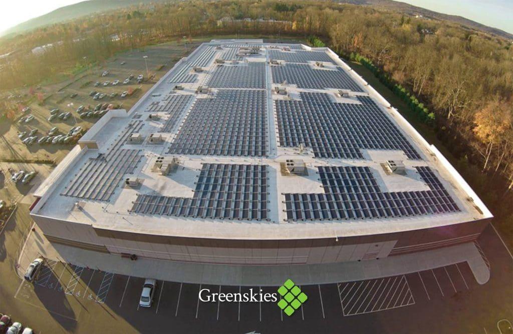 An image advertising Greenskies Renewable Energy, chosen by Norwalk to be its solar energy partner.