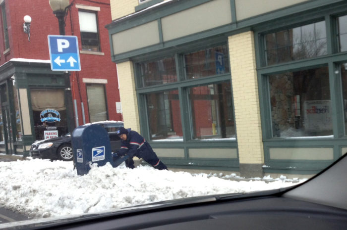 A mailman struggles in South Norwalk. (Contributed)