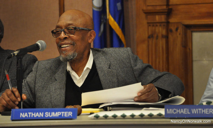 Norwalk Zoning Commission Chairman Nate Sumpter grins Wednesday after a reference to the Dunkin Donuts at 195 Main Ave.