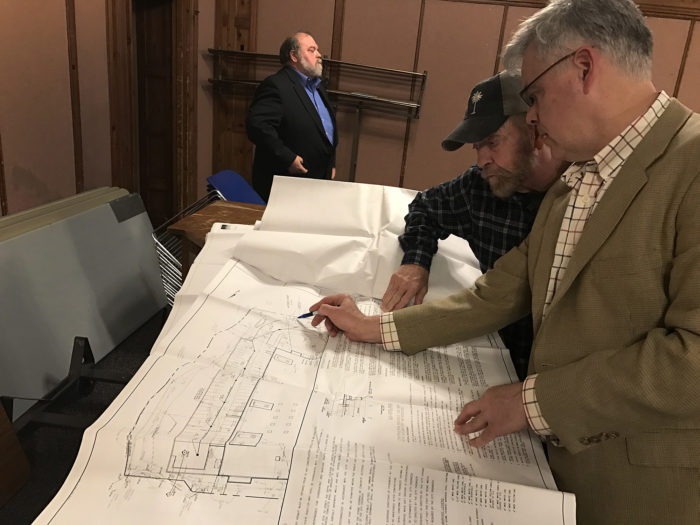"""Assistant Planning and Zoning Director Mike Wrinn, right, shows the plan for """"The Village"""" to a concerned citizen Wednesday in City Hall."""