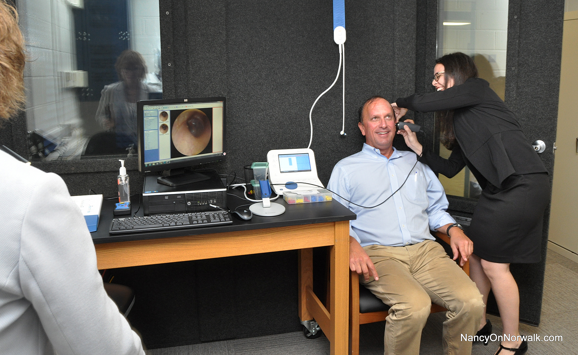 Norwalk Board Of Education Chairman Mike Barbis Has His Ear Cs Examined Tuesday At The Center For Specialized Learning In Literacy